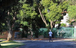 Laborers walk to work in South Africa. Black laborers walk to work through a residential suburb in post-apartheid South Africa as there is no reliable public royalty free stock photos
