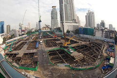 Laborers work at the construction site of a building. Laborers work at the construction site of a building in Bangkok,Thailand royalty free stock image