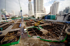 Laborers work at the construction site of a building. Laborers work at the construction site of a building in Bangkok,Thailand stock photo