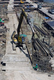 Laborers work at the construction site of a building. Laborers work at the construction site of a building in Bangkok,Thailand stock image