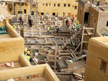 Laborers working on rehab in the Chouwara leather tannery in the Fez El Bali Medina. Fez, Morocco - December 14, 2015: Laborers working on rehab in the Chouwara stock photo