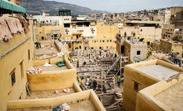 Laborers working on rehab in the Chouwara leather tannery in the Fez El Bali Medina. Royalty Free Stock Images