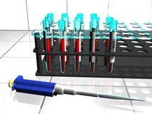 Laborgefäße und -pipette stockbild