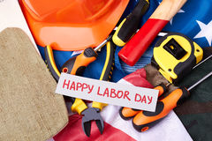 Labour Day card on flag. Stock Photo