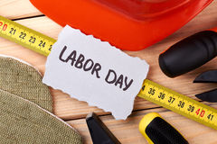 Labour Day card among instruments. stock photos