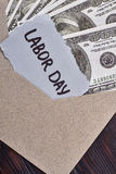 Labour Day card near dollars. royalty free stock photography