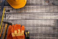Labour Day,  Many handy tools on wooden background texture.  stock photography