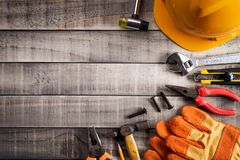 Labour Day,  Many handy tools on wooden background texture.  royalty free stock photos