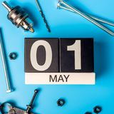 Labour day. May 1st. Day 1 of may month, calendar on blue background with tools.  royalty free stock image