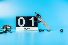 Labour day. May 1st. Day 1 of may month, calendar on blue background with tools.  stock images
