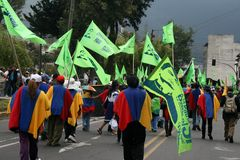 Labour Day parade. QUITO, ECUADOR - MAY 01: People marching in the parade on International Workers Day, also known as Labour Day, on may 01, 2012 in Quito Royalty Free Stock Photo