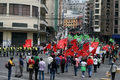 Labour Day parade. QUITO, ECUADOR - MAY 01: People marching in the parade on International Workers Day, also known as Labour Day, on may 01, 2012 in Quito Stock Images