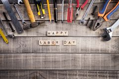 Labour Day, Wooden Block calendar with many handy tools on wooden background texture.  royalty free stock image