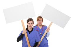 Labour dispute. Two women demonstrate with placards Stock Images