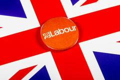 Labour Party Pin Badge. LONDON, UK - MAY 2ND 2017: A Labour Party pin badge over the UK flag, on 2nd May 2017 Royalty Free Stock Photography