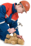 Labourer with bear and hammer Royalty Free Stock Image