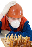 Labourer with chess Royalty Free Stock Photography