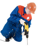 Labourer with hand drill Stock Photos