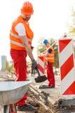 Labourer in orange safety helmet Royalty Free Stock Images