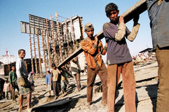 Labours. Workers carry pieces of iron from old cut vessel, CHittagong, Bangladesh Date: March 2008 Royalty Free Stock Images