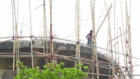 Labours demolishing concrete structure, Howrah, West Bengal, India. HOWRAH , INDIA - JUNE 26, 2016 : Labours demolishing a high concrete structure with drill stock footage