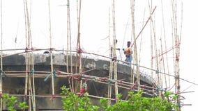 Labours demolishing concrete structure, Howrah, West Bengal, India. HOWRAH , INDIA - JUNE 26, 2016 : Labours demolishing a high concrete structure with drill stock video