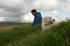 Labradoodle and owner. Stock Images