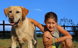 Labrador Retriever with lilttle girl in the park. Big Dog Labrador Retriever with lilttle girl in the park Royalty Free Stock Photography
