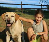 Labrador Retriever and a little girl outdoor Royalty Free Stock Photos