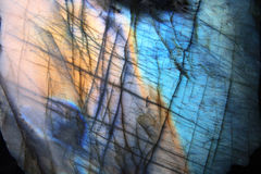 Labradorite. Natural golden and blue mineral background Stock Image