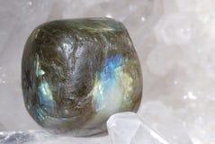 Labradorite laid on druze of quartz Stock Photos