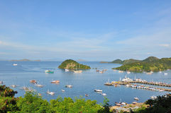 Labuan Bajo. Once a small fishing village, Labuan Bajo (also spelled Labuhanbajo and Labuanbajo) in Flores is now a busy bustling epicenter of tourism. It is the Royalty Free Stock Photo