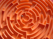 Labyrinth. Orange labyrinth with small metal ball inside Stock Photo