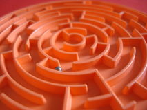 Labyrinth. Orange labyrinth with small metal ball inside Royalty Free Stock Photo
