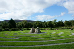 Labyrinth. Grass maze in labyrinth with center stones Royalty Free Stock Image