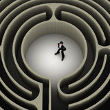 Labyrinth. An executive in the middle of a labyrinth finding his way out stock illustration