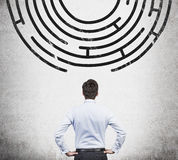 Labyrinth. Businessman looking to out way of the labyrinth Stock Image