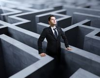 Labyrinth. Businessman standing in a labyrinth Royalty Free Stock Photos