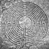 Labyrinth carved on stone Stock Images