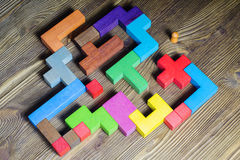 Labyrinth of colorful wooden blocks, tetris, top view. Royalty Free Stock Photo
