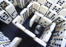 Labyrinth & Diamond. Domino - one of a set of small flat pieces of wood or plastic Royalty Free Stock Image