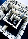 Labyrinth & Diamond. Domino - one of a set of small flat pieces of wood or plastic royalty free stock photos