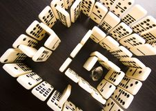 Labyrinth & Diamond. Domino - one of a set of small flat pieces of wood or plastic Stock Photography