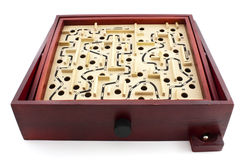 Labyrinth game. Of wood on white background Stock Photos