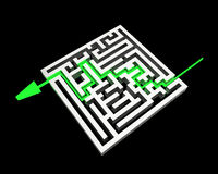 Labyrinth with green arrow Stock Photo