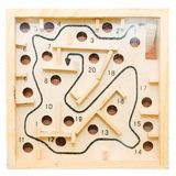Labyrinth with holes. Kid toy labyrinth with holes Royalty Free Stock Image