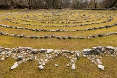 Labyrinth made of white stones on a green meadow near Beli on a sunny day in spring stock images