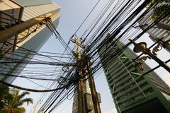 Labyrinth of power lines in Bangkok, Asia stock images