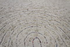 Labyrinth on the Sand Made Of Stones Royalty Free Stock Photography