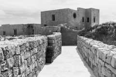 Labyrinth of streets in citadel. Victoria also known among the native Maltese as Rabat on maltese island Gozo. Labyrinth of narrow streets in the citadel. Black Stock Photos